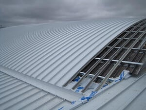industrial roof replacement with metal over metal recover