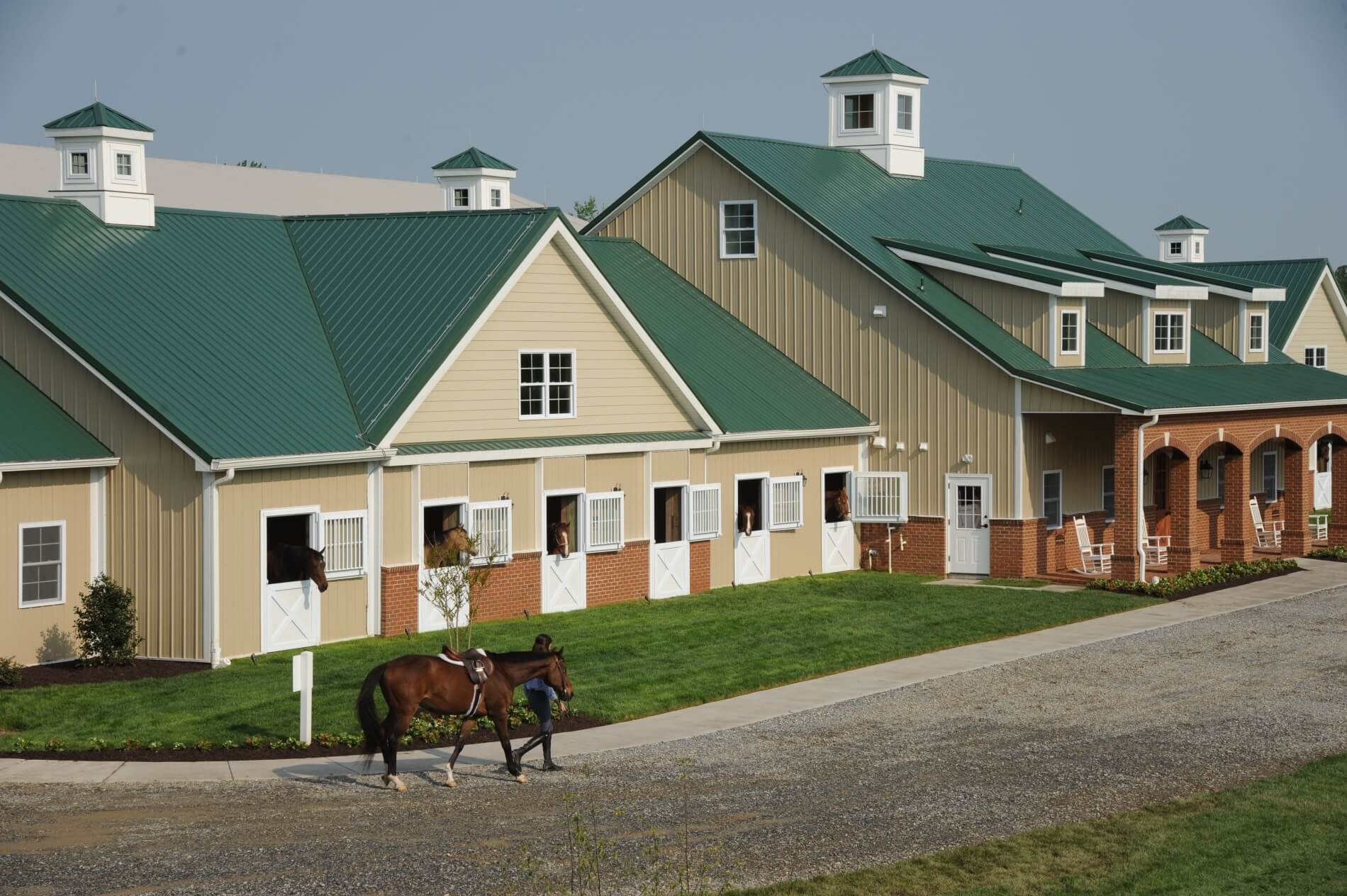 Exposed Fastener Panels specified and installed as roofing and most of the walls at award winning equestrian community facility