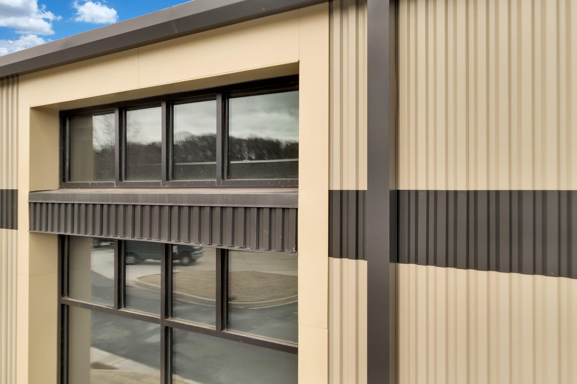 Gaffney-training-center-wave-panel-custom-coating