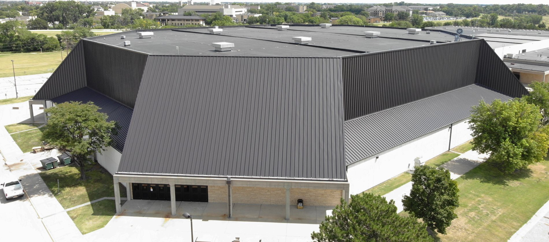 238T Symmetrical Panel Recovers Coliseum Roof and Wall