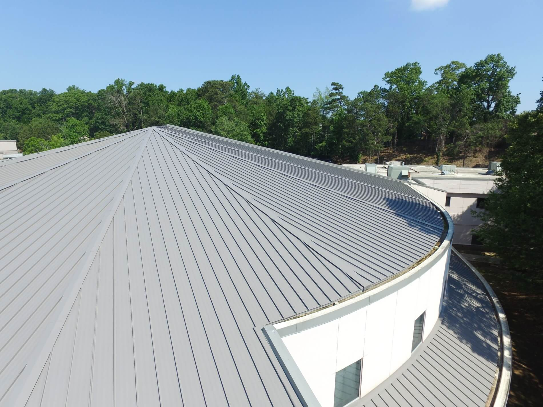 Retrofit roofing project challenges installers' measuring skills with multiple hips and tapered panels