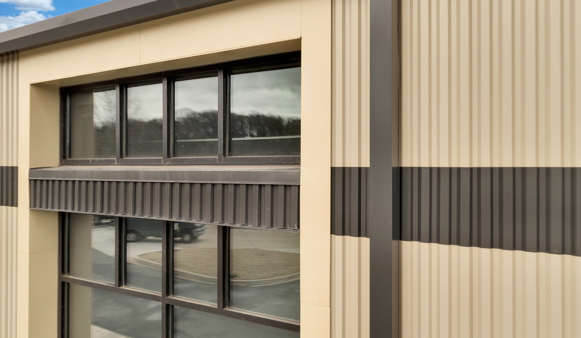 Wave panel serves as facade for training, strength facility in South Carolina