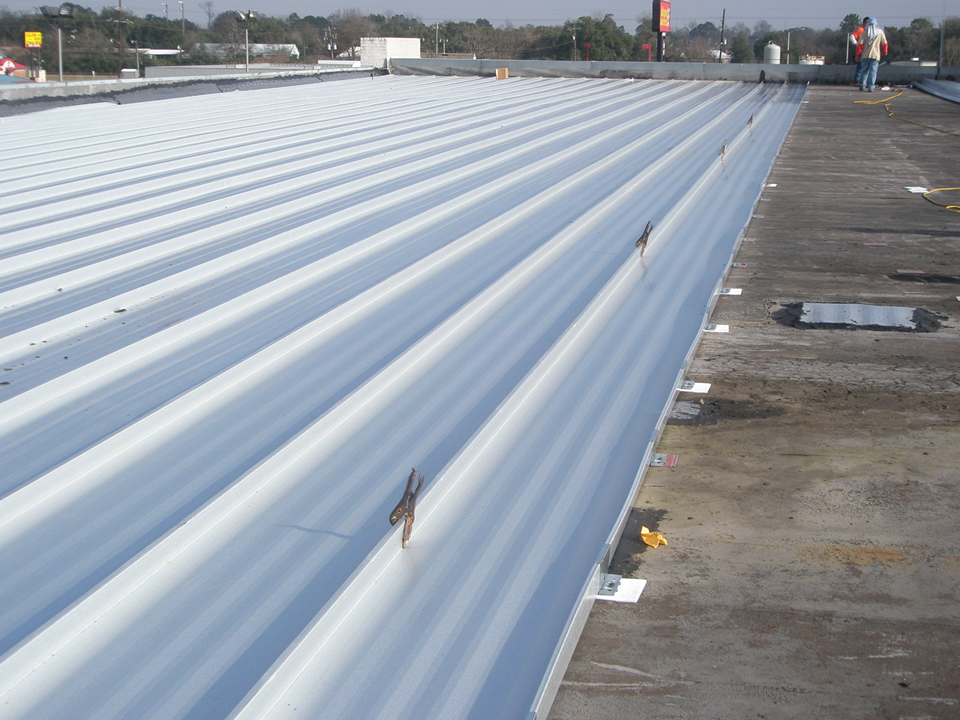how to retrofit a flat metal roof